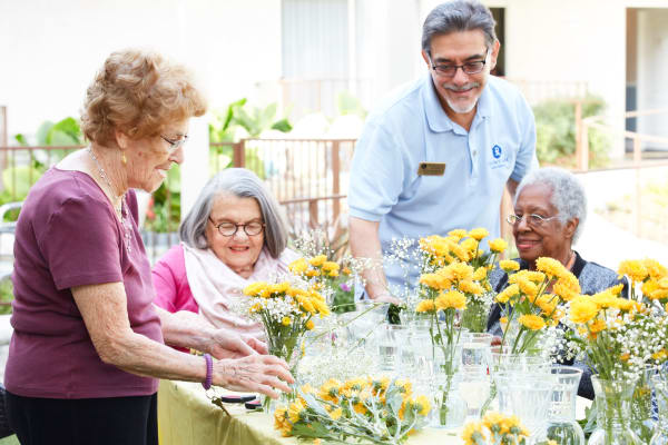 Residents at Regency Park Oak Knoll in Pasadena, California arranging flowers