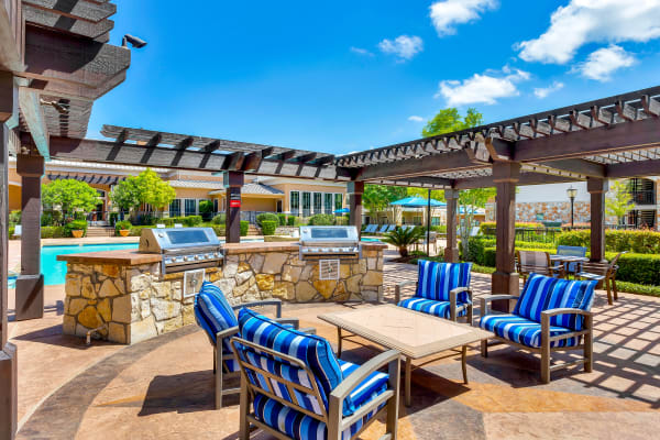 BBQ area by the pool at Onion Creek Luxury Apartments in Austin, Texas