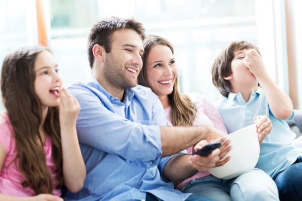 Family watching TV at The Venue in Rochester, New York