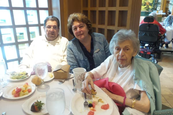 Resident enjoying a lovely mother's day meal at All Seasons of Birmingham in Birmingham, Michigan
