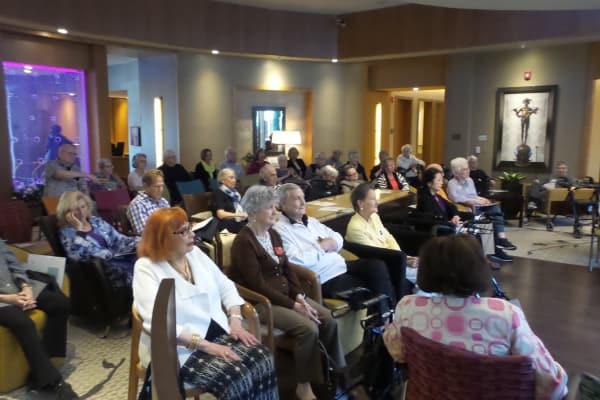 Residents enjoying the Mack Sisters performance at All Seasons of Birmingham in Birmingham, Michigan
