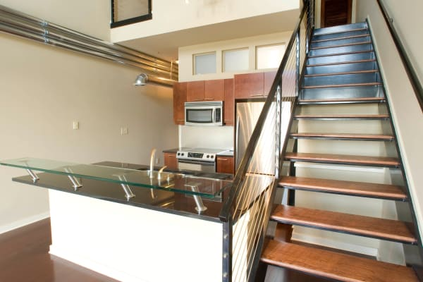 Kitchen with stainless-steel appliances at 17th Street Lofts in Atlanta, GA