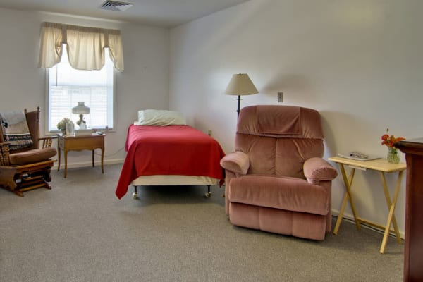 Assisted living apartment bedroom at Bluff Creek Terrace Senior Living in Columbia, Missouri