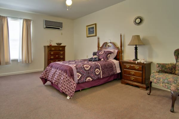 Assisted living apartment bedroom at Highland Crest Senior Living in Kirksville, Missouri