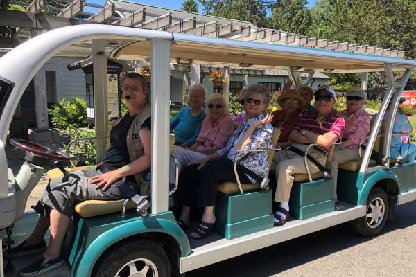 Seniors living a happy life here at Merrill Gardens at The University