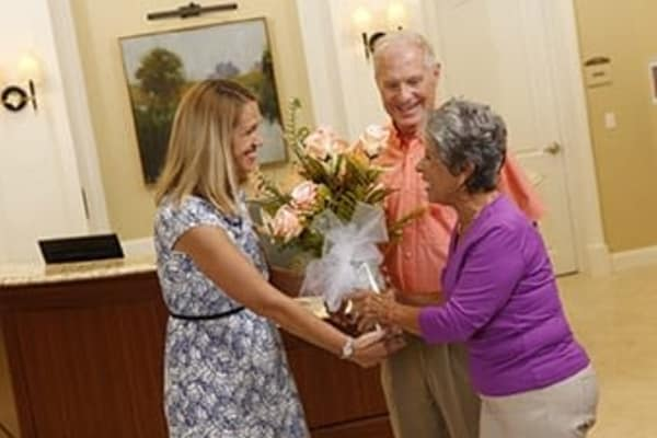 Concierge greeting to senior citizens at Discovery Commons At Wildewood in California, Maryland.