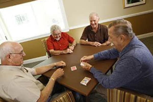 seniors playing cards at Discovery Commons At Bradenton in Bradenton, Florida