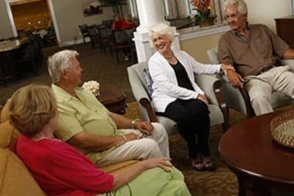 Senior living residents enjoying a conversation together at Discovery Commons
