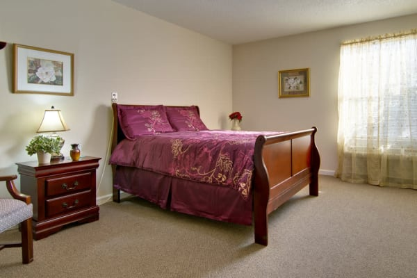 Assisted living apartment bedroom at Parkway Cove in Covington, Tennessee