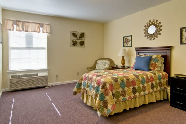 Assisted living apartment bedroom at Asbury Cove in Ripley, Tennessee