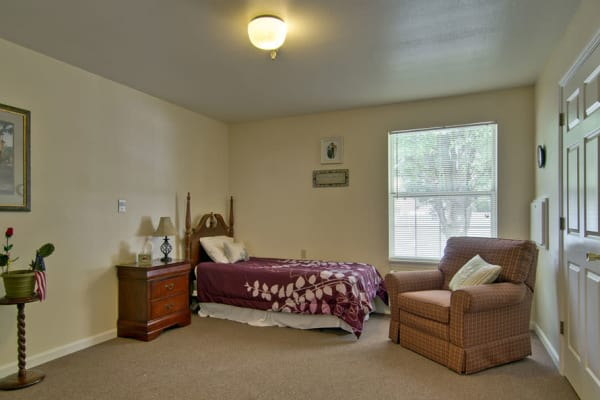 Assisted living apartment bedroom at Bradford Court in Nixa, Missouri