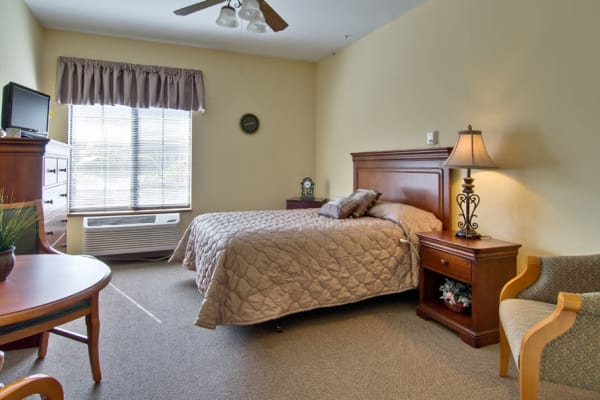 Assisted living apartment bedroom at Spencer Place in Saint Peters, Missouri