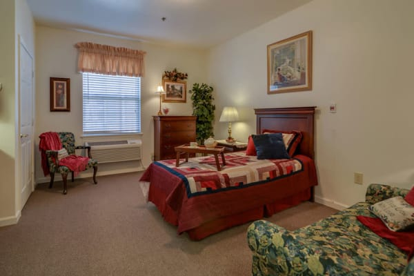 Assisted living apartment bedroom at Hickory Gardens in Madison, Tennessee
