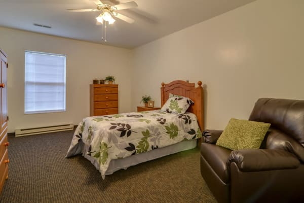 Assisted living apartment bedroom at Ashbrook in Farmington, Missouri
