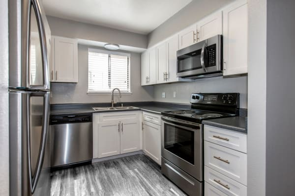 white model renovated kitchen at Bennington Apartments