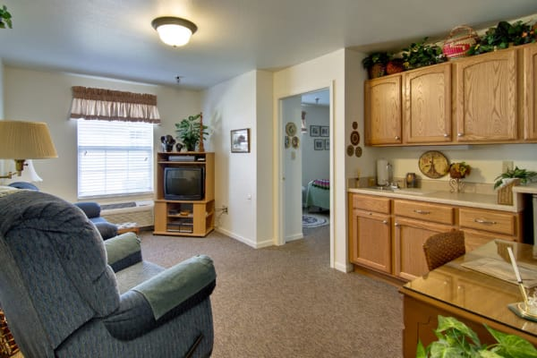 Assisted living apartment kitchen and living room at Henley Place in Neosho, Missouri