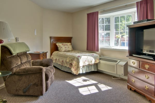 Assisted living apartment bedroom at Ashland Villa in Ashland, Missouri