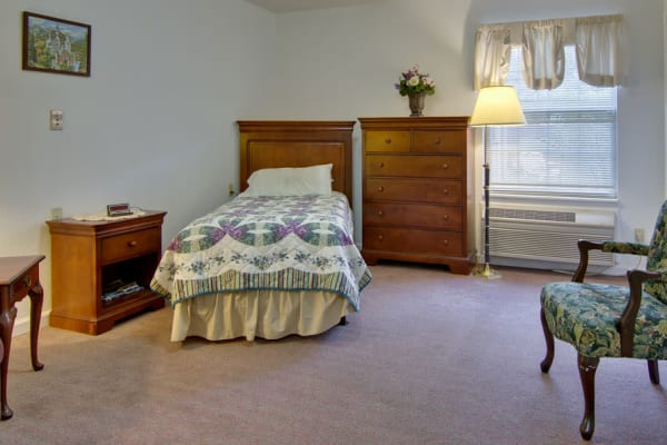 Assisted living apartment bedroom at Maple Tree Terrace in Carthage, Missouri