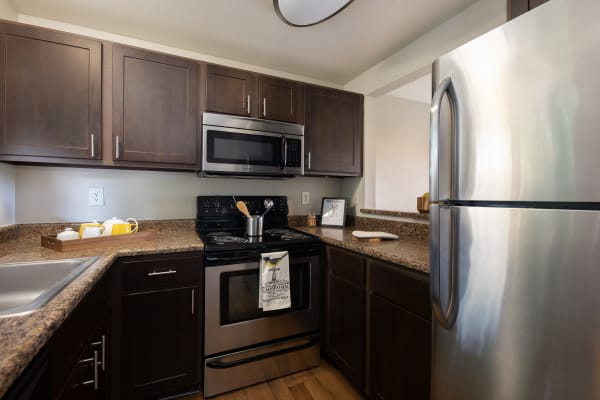 Renovated Brown Style Kitchen with Brown Cabinets. Model Unit at Latitude Apartments in Everett