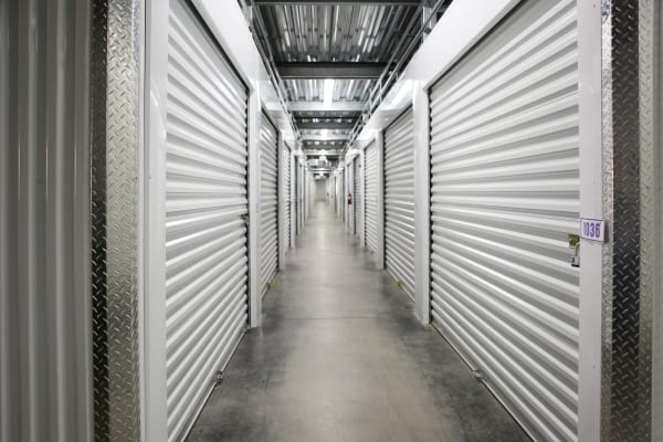 Interior units with white doors at StoreSmart Self-Storage in Columbia, South Carolina