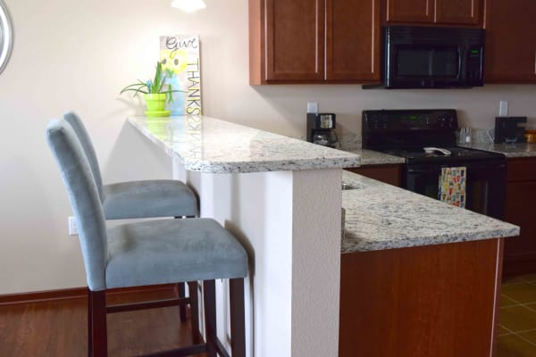 Upgraded kitchen with granite counter tops at Prairie Reserve in Cedar Rapids, Iowa