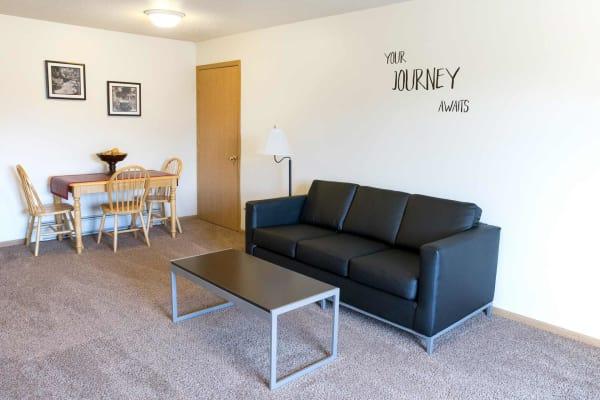 Apartment living room at Campus View & Kirkwood Court in Cedar Rapids, Iowa