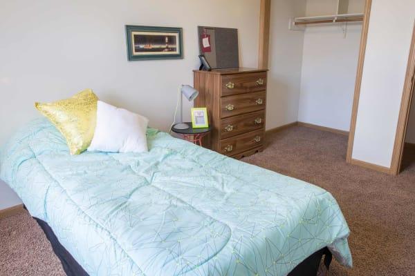 Apartment bedroom at Campus View & Kirkwood Court in Cedar Rapids, Iowa