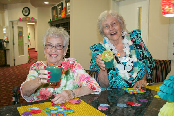 Two residents from Alexis Estates Gracious Retirement Living in Allen, Texas, with drinks
