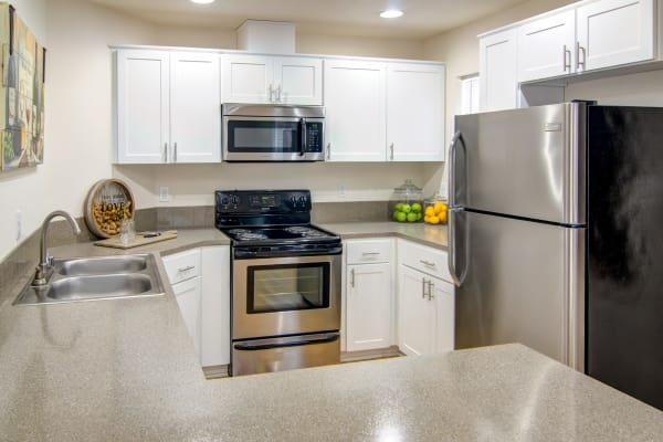white renovated kitchen with stainless steel appliances at The Addison Apartments in Vancouver