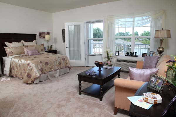 Spacious bedroom at Cottonwood Estates Gracious Retirement Living in Alpharetta, Georgia