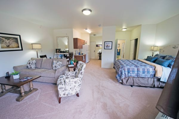 Bedroom and living room at Desert Springs Gracious Retirement Living in Oro Valley, Arizona