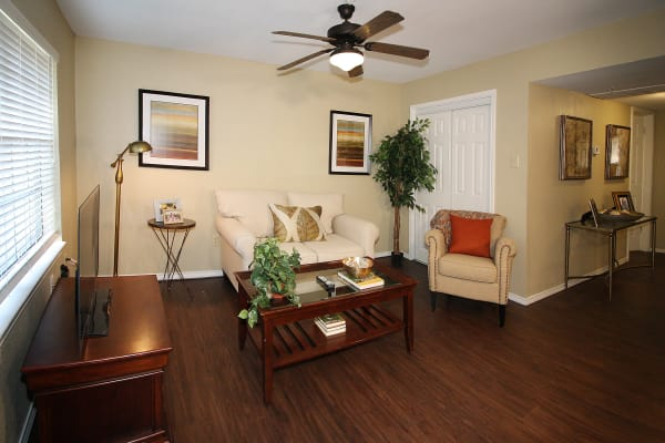 Model living room with ceiling fan at West Fork Village in Irving, Texas