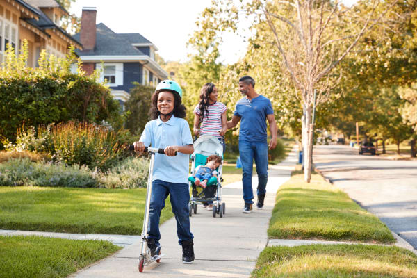 Family going for a walk near Jamestown Square Apartments in Blackwood, New Jersey