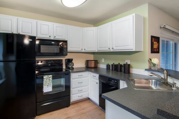 renovated white kitchen model at Autumn Chase Apartments in Vancouver
