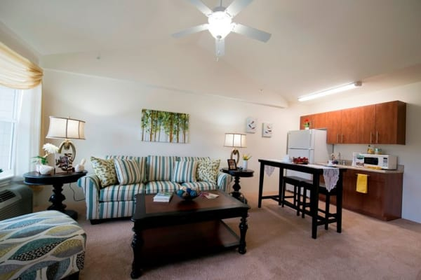 Living room and kitchen at Northridge Gracious Retirement Living in Fishers, Indiana