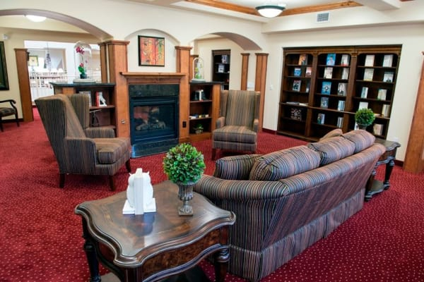 Cozy seating in the library at Northridge Gracious Retirement Living in Fishers, Indiana