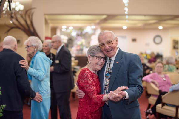 Two residents dancing together at Somerset Lodge in Gladstone, Oregon