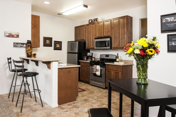 Dark wood cabinets in the kitchen at Villa Risa Apartments in Chico, California