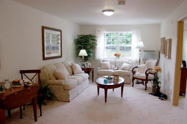 A well decorated living room at Steeplechase Retirement Residence in Oxford, Florida