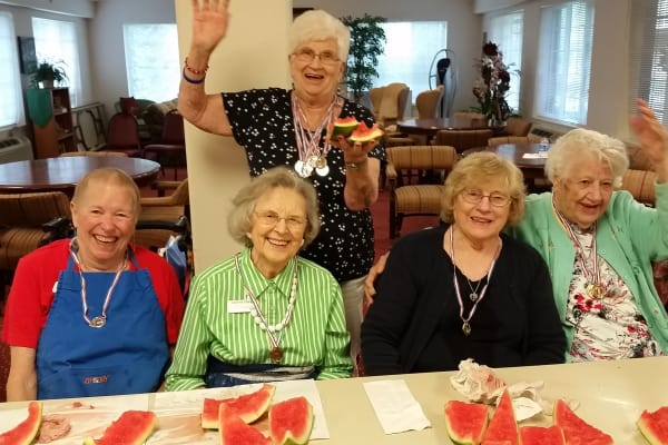 Residents posing for a photo with watermelon at Sterling Heights Gracious Retirement Living in Bethlehem, Pennsylvania