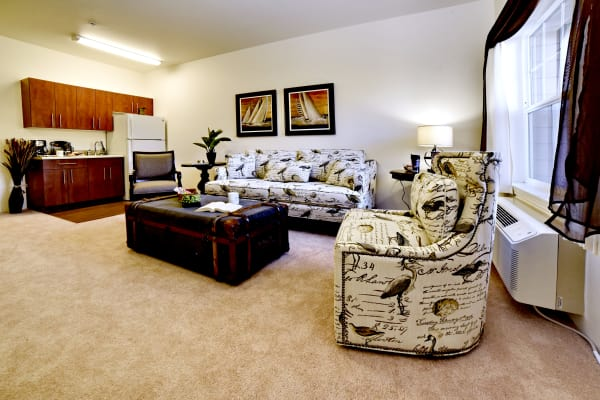 An apartment living room and kitchen at Sterling Heights Gracious Retirement Living in Bethlehem, Pennsylvania