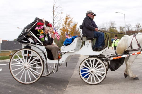Residents from Stoneridge Gracious Retirement Living in Cary, North Carolina in a horse drawn carriage