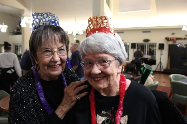 Two happy residents on New Years Eve at Summit Glen in Colorado Springs, Colorado