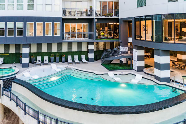 Rooftop in-ground pool and spa with skyline and river views at Bayou on the Bend in Houston, Texas