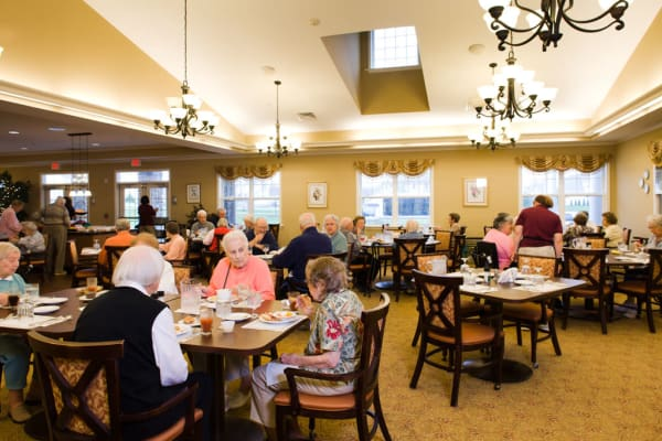 Resident sharing a meal with a friends at Traditions of Hershey in Palmyra, Pennsylvania