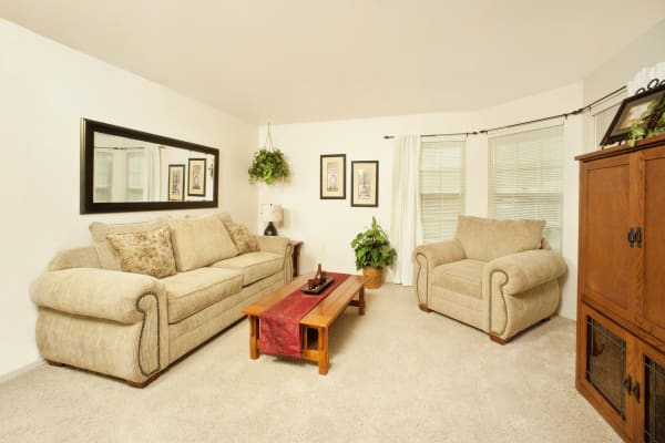 Living room in model home at Oak Meadow Apartments in Chico, California