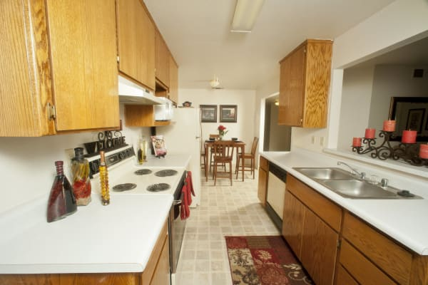 Wood cabinets in the kitchen at Oak Meadow Apartments in Chico, California
