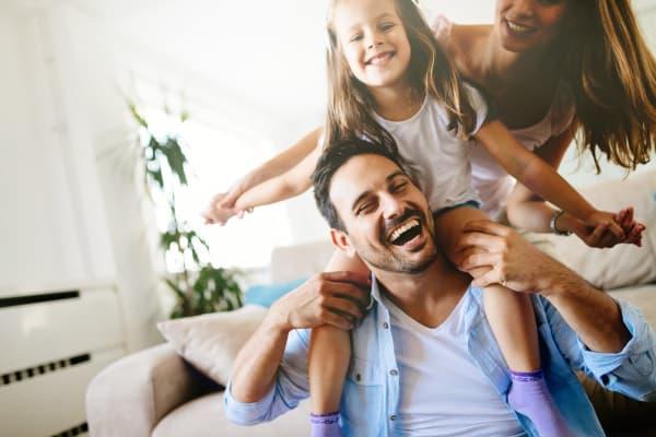 Family having fun at Avilla Meadows in Surprise, Arizona