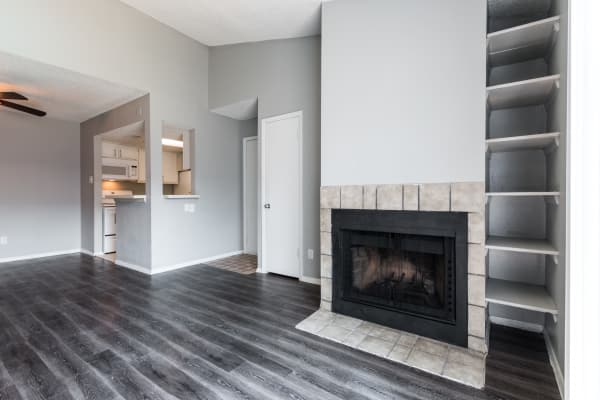 A fireplace in the living room at Northchase Apartments in Austin, Texas