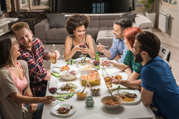 Residents enjoying dinner with friends in the neighborhood near Echelon Luxury Apartments in Cincinnati, Ohio